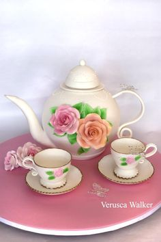 Teapot cake with sugar teacups.  Found through cakewrecks.com