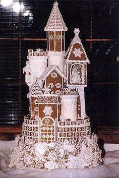 I think it passed Gingerbread House a while ago. more like a Gingerbread Castle! Gingerbread Castle, Christmas Gingerbread House, Noel Christmas, Christmas Treats, All Things Christmas, Christmas Cookies, Christmas Decorations, Gingerbread Wedding Cakes, Christmas Wedding