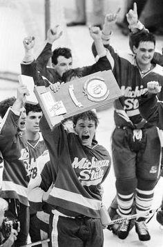 Jeff Parker hoists the 1986 NCAA Hockey Championship trophy.