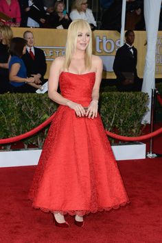 Kaley Cuoco Strapless Dress - Kaley went for a retro look on the red carpet in this strapless red tea-length dress.