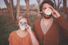 would make a cute engagement picture. if only the girl would hold her pinky up a bit higher to show the ring and the wedding date on the bottom of the mugs or something like that.