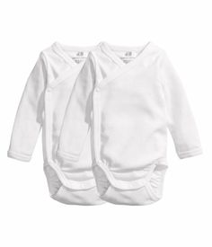 Kimono-style, or wraparound, onesies are great because most babies hate anything going over their head. With these you can just set them inside.