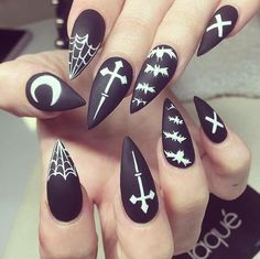 Matte black stiletto nails. Occult style with bats and spider webs.
