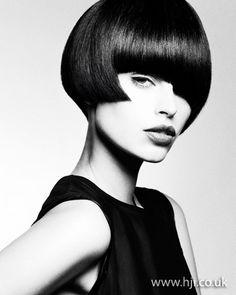2012 brunette short womens hairstyle hairstyle    A classic black A-line bob was prepped with smoothing cr�me and blow-dried using a round brush to achieve a smooth finish with volume through the roots and tucked-under ends. Once dry, hair was finished with straighteners and misted with shine spray.     Hairstyle by: Joey Scandizzo  Hairstyle picture by: Andrew O'Toole  Salon: Joey Scandizzo Salon  Location: Australia