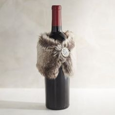 Present your gift of wine with a little panache by wrapping the bottle in a faux fur stole accented with bling. Since you know you'll be attending several parties, buy a few for hostess gifts.