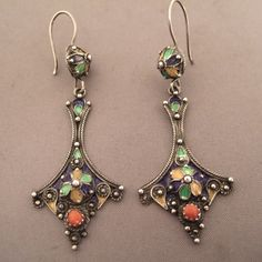 A pair of Berber kabyl earrings ... beautiful patina and nice coral on the bottom of the earrings!