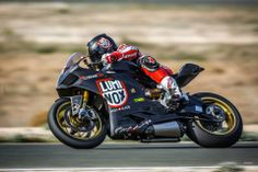 Panigale oversized carbon fuel tank in action on track