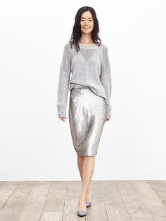 This classic cable-knit pullover with sheer mesh trim is an update on your go-to gray winter sweater. Pair it with a sequin skirt for an extra flirty look | Banana Republic
