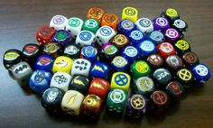 Assorted custom superhero dice including: xmen, lantern corps, spiderman, green goblin, batman, superman, deadpool, spiderman, avengers, iron man, magneto, SHIELD, hydra, hulk, fantastic four