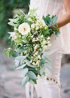 Beautiful cascading blush and greens wedding bouquet Photo by Jose Villa