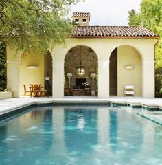 Love this little pool house.