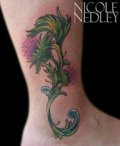 Thistle flower by Nicole Nedley at Family Tradition Tattoo in Marietta, GA.
