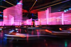 a series of experimental photos with long time exposure at a autoscooter with new cars, illuminated by LED lights  [CF_2015-04-23_192750(7D).JPG]