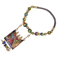 "William Harper necklace titled ""Sherhergades's Mystery"". This handcrafted necklace is in gold, silver,enamel and glass."
