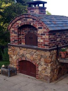 "We finally put the finishing touches, slate roof, steel doors, on our 42"" Pompeii style wood fired oven. To view a slideshow of our build goto: https://www.youtube.com/watch?v=wWHPC30w_JY&feature=youtu.be rbhumberth?v=wWHPC30w_JY&feature=youtu.be."