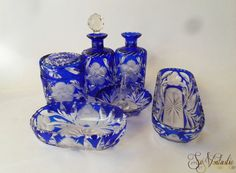 A lovely vintage Bohemian cut to clear crystal cobalt vanity set / deep blue Czech art glass boudoir dressing table set including 2 decanters, a lidded jar, ring stand, soap dish and a comb brush tray. Flower cut pattern! On offer by SoVintastic on Etsy