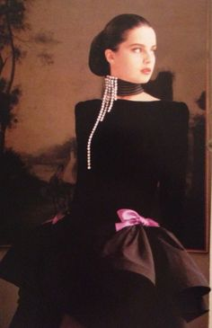 Pierre Cardin Haute Couture- A/W 1987-88 Black velvet and silk satin long sleeve dress with a high neckline and two pink satin bows. L'Officiel No. 734- September 1987