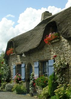 Thatched cottage in Normandy, France. I loved my bike rides in '88. I noticed a lot of these homes.