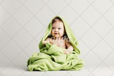 Cute Baby Girl Covered in Green Blanket
