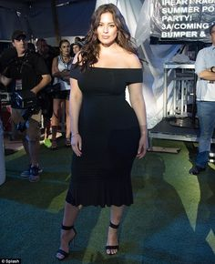 Absolutely breathtaking: Ashley Graham looked incredible while rocking an off-the-shoulder black dress with strappy heels and wavy tresses