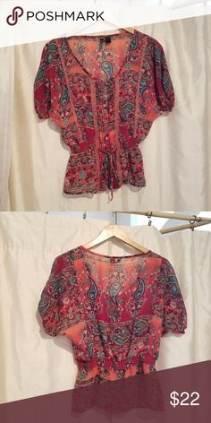 Full Tilt Floral & Paisley Blouse Cute floral & Paisley print this blouse has small buttons on the front along with unique sewn features that add beautiful detail. The middle also has a sewn ruched band with a fabric tie!! The color ranges from dark pinks to a maroon red. This piece has been lightly used for special occasions as a dress up piece, no stains/fading & all buttons are also intact!! Full Tilt Tops Blouses