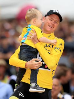 Team Sky's Chris Froome celebrates with his son Kellan after stage 21 of the Tour de France in Paris France