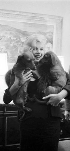 """Marilyn and her dachshunds .1959"""