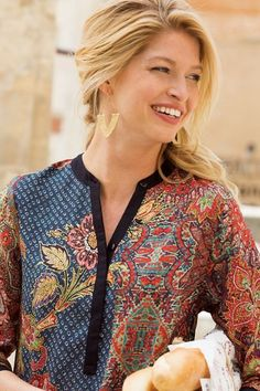 A vintage faded print makes up the front, long sleeves and back yoke of this sensuously silky tunic. The black neckline, partial hidden-button closure, button cuffs and dropped-tail hem deliver contrasting drama. Misses long. Sewing Blouses, Agra, Soft Surroundings, Late Summer, Women Tunic, Tunic Tops, Blazer, Pakistani, Long Sleeve