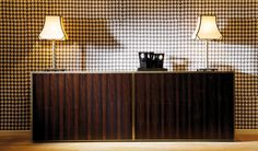 DOM Edizioni -Lucas cabinet, macassar ebony doors. bronzed metal outlines