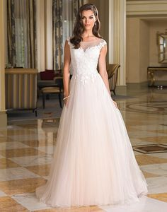 Justin Alexander 8852 (Dundee) he soft fabrication and lace details of this  vintage inspired ball gown with a Sabrina neckline 86da4667df72