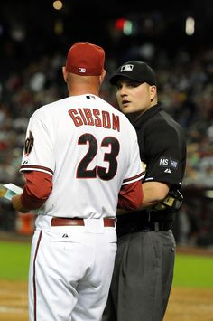 PHOENIX, AZ - APRIL 16: Manager Kirk Gibson #23 of the Arizona Diamondbacks talks with home plate umpire Dan Bellino #2 late in the game against the Pittsburgh Pirates at Chase Field on April 16, 2012 in Phoenix, Arizona. Arizona won 5-1. (Photo by Norm Hall/Getty Images)