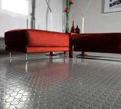 Rubber Flooring by Flexco.  Designed for durability, versatility and slip resistance + very quiet and comfortable under foot.