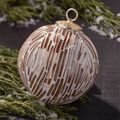 Shards of glass from broken bangles are carefully pressed into cement by skilled artisans in India to form these unusual Christmas ornaments. Ball Ornaments, Glass Christmas Ornaments, Christmas Balls, Christmas Ideas, Christmas 2016, Merry Christmas, Rose Gold Christmas Decorations, Merry And Bright, Christmas Traditions