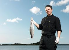 Chef holding fish