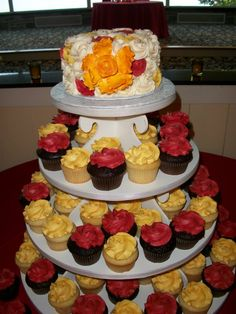 Rosettes for this cupcake tower , beautiful fall display.