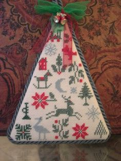 completed cross stitch prairie schooler Christmas tree ornament, omg