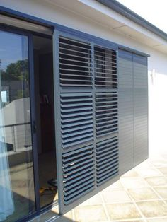 The Aluvent adjustable blade shutters comprises of low maintenance aluminium louvre blades enclosed within an aluminium frame. Balcony Grill Design, Window Grill Design, House Shutters, Window Shutters, Bermuda Shutters, Outdoor Blinds, Shutter Doors, Sliding Glass Door, Sliding Patio Doors