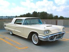 I had one like this in 1965 but it caught on fire twice! It's a 1960 Yellow and White Ford Thunderbird. A beautiful car!