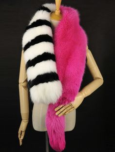 Make a statement and layer our black white stripe and pink Bagi fur scarf with your ensemble for a luxurious and chic vibe. Customize your colors. Made of fox fur. You may customize your color by cont