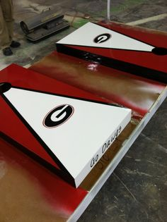 These are great @Olivia McCullough :) - UGA Cornhole Boards!  Contact me if you would like a set!