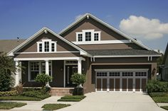 exterior house paint color combinations | addition of carriage house style garage doors in a complementing color ...
