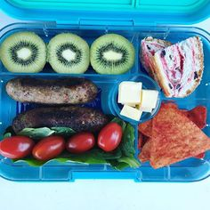 The kids like leftover sausages in the lunchbox. kiwi fruit | jam scroll | tortilla chips | cheese | salad | sausages #bafm_lunchbox