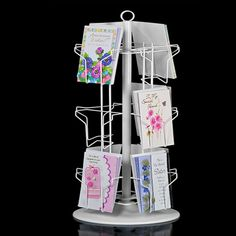 Rotating greeting card display w sign clip countertop 16 pockets when you want to display a few greeting cards on a countertop or other surface this countertop greeting card spinner is the ideal solution m4hsunfo