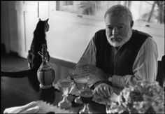 In the Hemingway house the cats roam everywhere, even monopolise the dining table.    These photos were taken in 1954 prior to Ernest HEMINGWAY's visit to Sweden to collect the Nobel Prize for Literature (1954) and show him and his wife Mary Welsh at their home in Cuba. It is called LA FINCA VIGIA (Lookout Farm) and is located in San Francisco de Paula in Cuba amongst thirteen acres of land and gardens, and an orchard, an oasis in the decaying Cuban town.