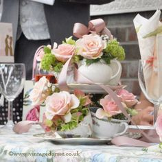 tea cups and flowers centerpiece