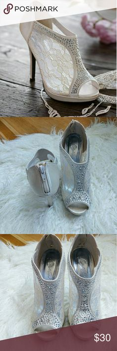 "Lace High Heel Shootie with Flatback Crystals Size 7 Color Ivory Zipper back 1/2"" platform 4.5"" heel Worn once in a wedding about 2 years ago. Great condition, no holes, or tears!   No trade Make me an offer! Michaelangelo Shoes Heels"