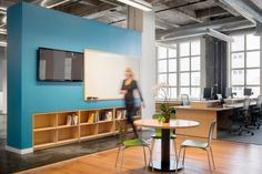 partial height wall with flush millwork shelves as collaborative break out space