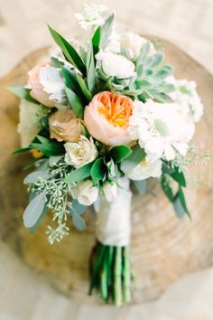 Stunning white and green bouquet with a hint of blush. Photo by Mint Photography. #wedding #bouquet #blushflowers