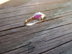 Vintage Gold Ring. 10 Karat Gold with Ruby and 2 Clear Stones. Stamped 10K, Size 7  Ask a Question $100.00 USD Only 1 available