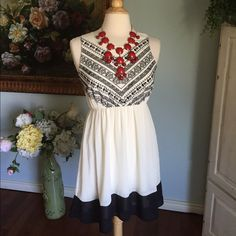 Pretty ivory and black summer dress Beautiful ivory and black summer dress. Fun Aztec designs on top. Elastic waist. Fully lined. Fits a 2/4. Excellent shape! Ya Los Angeles Dresses Midi